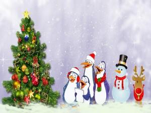 Pingüinos cantando alrededor del árbol de Navidad