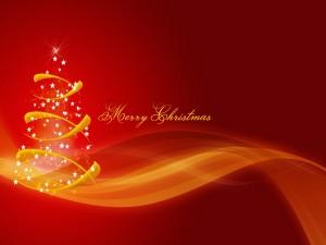 Mensaje navideño junto a un árbol