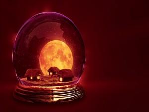 Pueblo navideño dentro de una bola
