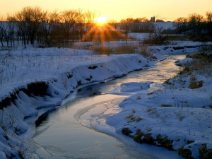 Sol sobre un paisaje nevado