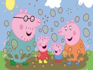 Peppa Pig y su familia disfrutando del barro