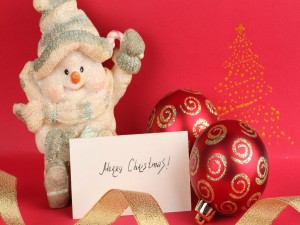 Muñeco de nieve con una felicitación para Navidad