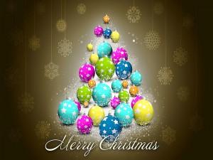 Feliz Navidad junto al árbol