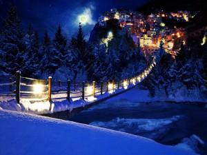 Puente cubierto de nieve en una ciudad fantástica