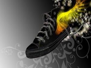 Zapatillas de deporte con alas brillantes y estrellas