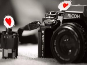 Carrete y cámara de fotos