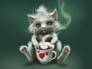 Gatito sentado con una taza de chocolate