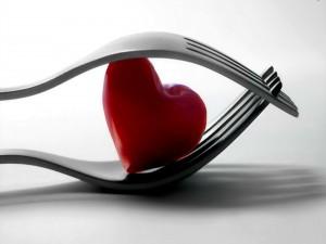 Un corazón atrapado entre dos tenedores
