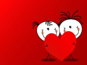Una pareja de niños sosteniendo un corazón