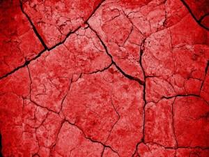 Unas grietas en el suelo rojo