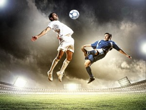 Jugadores de fútbol practicando en el estadio