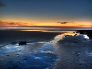 Magnifica salida del sol en la playa