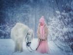 Una niña con su caballo blanco en la nieve