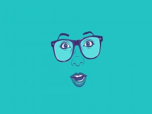 La cara de una chica con gafas