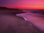 Amanecer en una gran playa