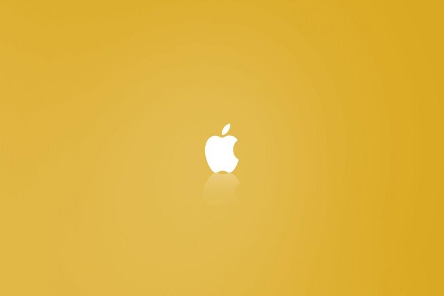 Logo de Apple en un fondo amarillo