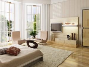 Dormitorio con sillones, pantalla de televisión y grandes ventanales