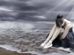 Bailarina triste a orillas del mar
