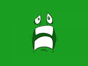 Cara verde asustada