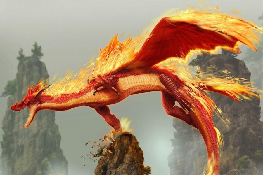 Dragón en llamas volando sobre rocas