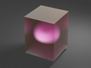 Cubo con una esfera de color rosa en su interior