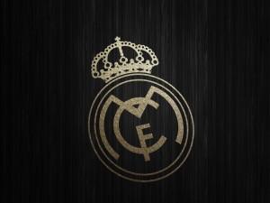Escudo del Real Madrid en fondo negro
