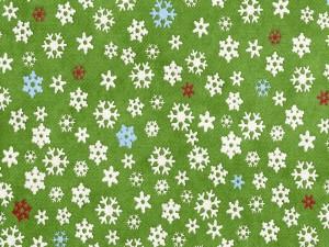 Copos de nieve sobre un fondo verde