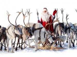 Santa Claus con sus renos