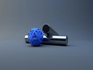 Pelota de goma azul y cilindros de metal